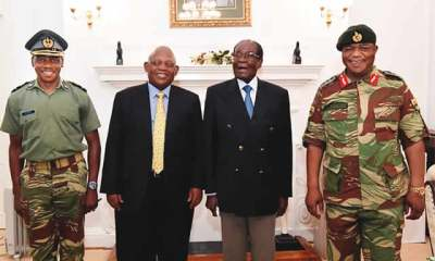 Mugabe resists military pressure to resign