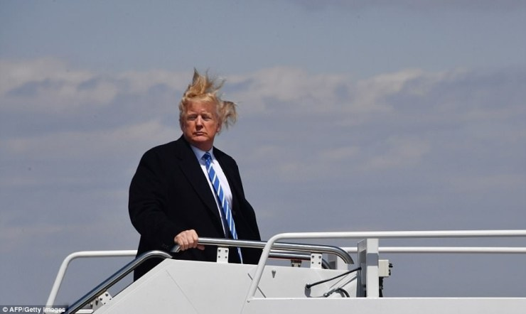 Trump's hair goes wild in wind as he boards Air Force One to West Virginia