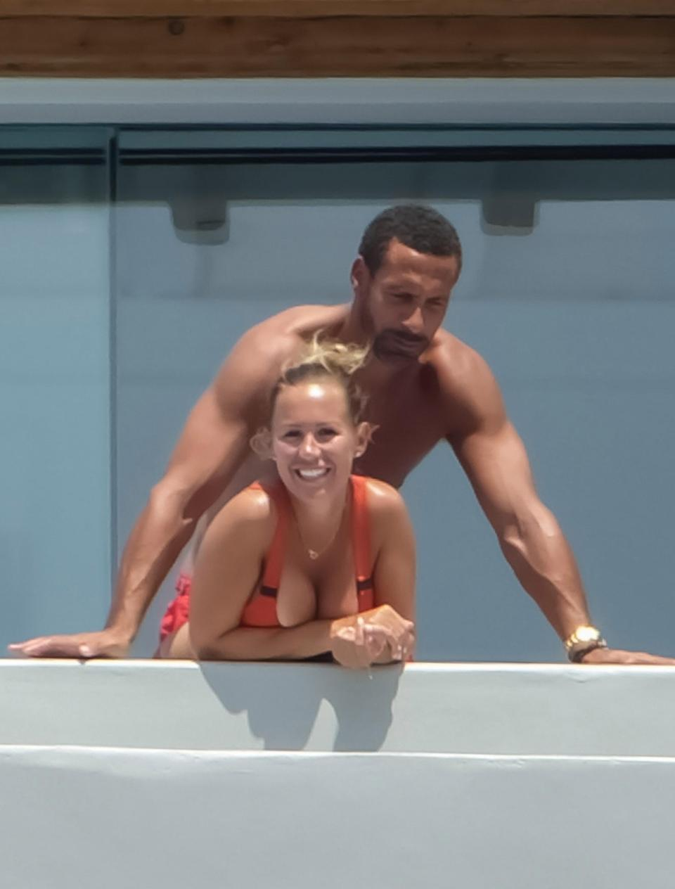 Kate Wright and Rio Ferdinand cuddle up during a romantic holiday in Mykonos