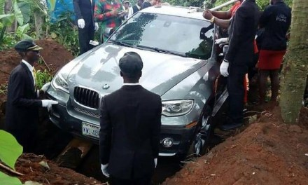 Nigerian man reportedly buries his father in BMW (photo)