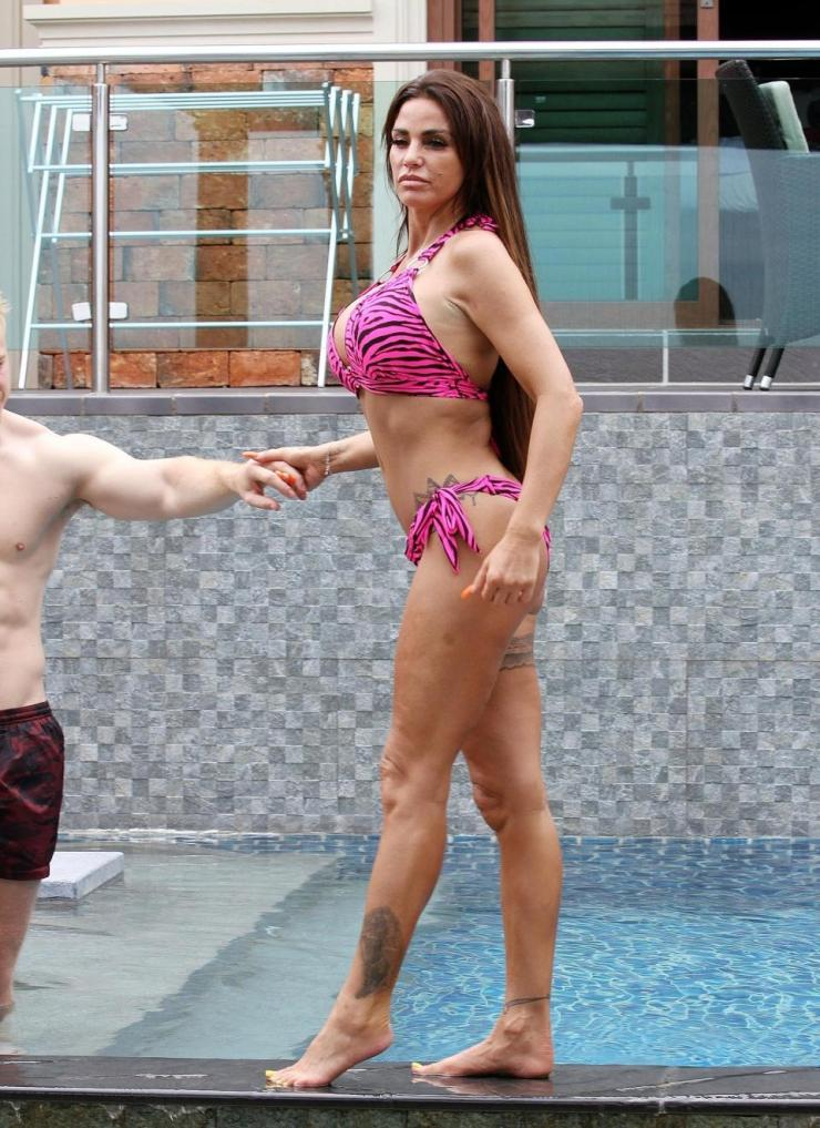 Katie Price flaunts her curves as she snogs boyfriend Kris Boyson poolside in Thailand