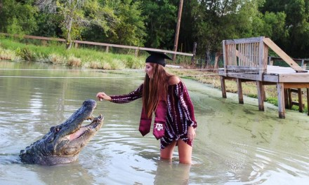 College student poses with a nearly 14-foot long and 1,000-pound alligator for jaw-dropping graduation photoshoot (Photos)