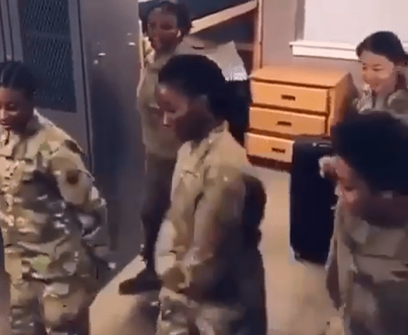Video of a female Nigerian-born US soldier teaching other female soldiers some Nigerian dance steps