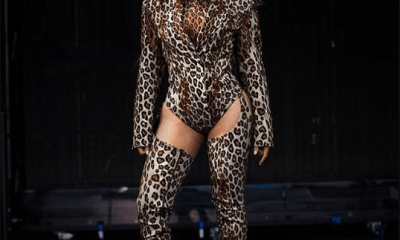 Beyonce flaunts her long legs in fierce leopard print leotard and matching thigh-high boots in new photos