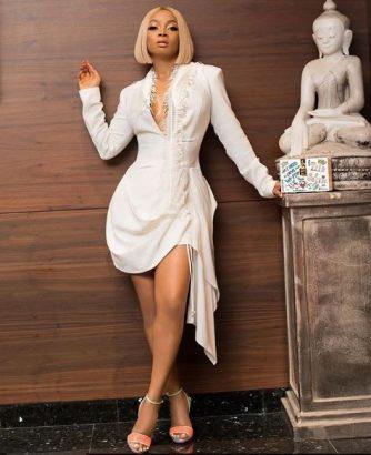 Toke Makinwa flaunts curves in short wihe gown