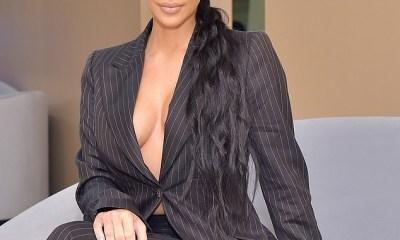 Kim Kardashian flaunts her cleavage in oversize matching suit