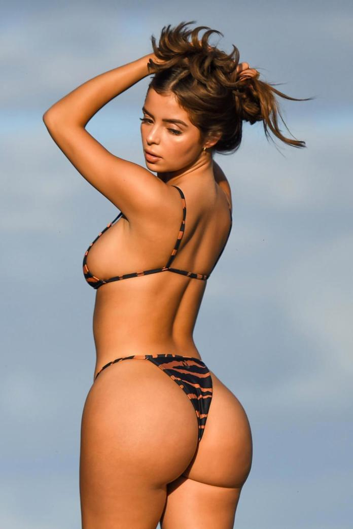 Demi Rose flaunts curves in tiger print bikini during photoshoot in Mexico