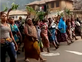 Women take to the streets to protest the renewed political violence in Kogi