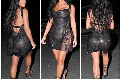 Sexy Kim Kardashian puts on a cheeky display in slightly sheer vintage Versace mini dress
