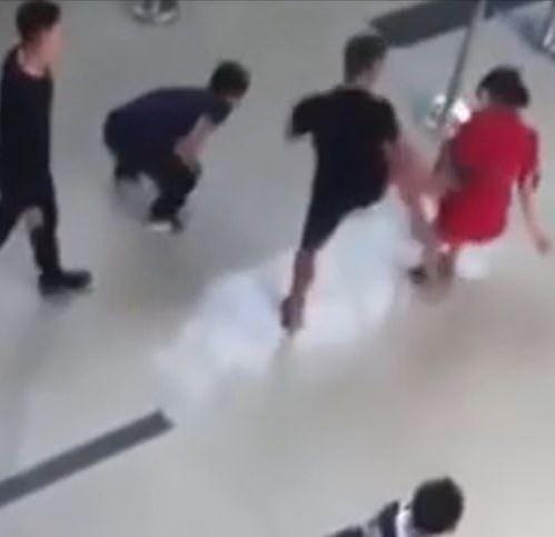 Moment airline worker is kicked to the ground by drunken man