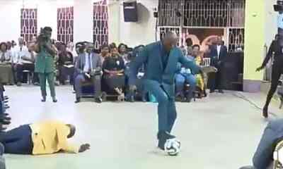 Pastor performs deliverance on church members using football