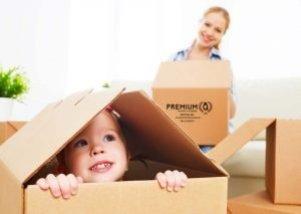 a child in a cardboard box