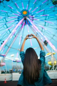 girl and a ferris wheel