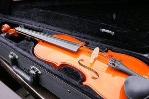 a violin in a hard black case