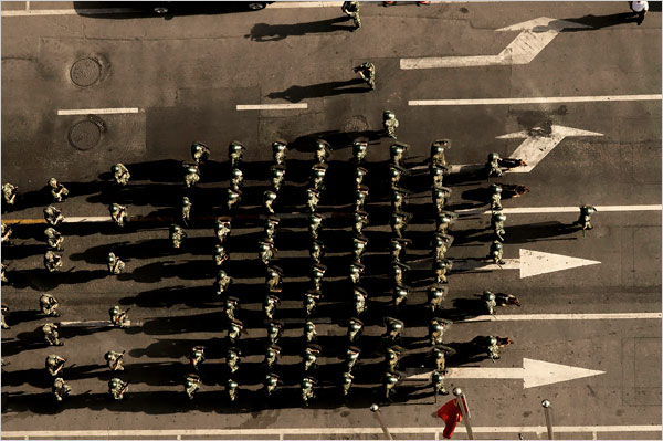 """""""Police officers marching in Urumqi"""". Photo by Gilles Sabrie for The New York Times"""