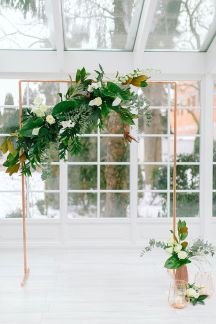 Copper wedding arch with flowers