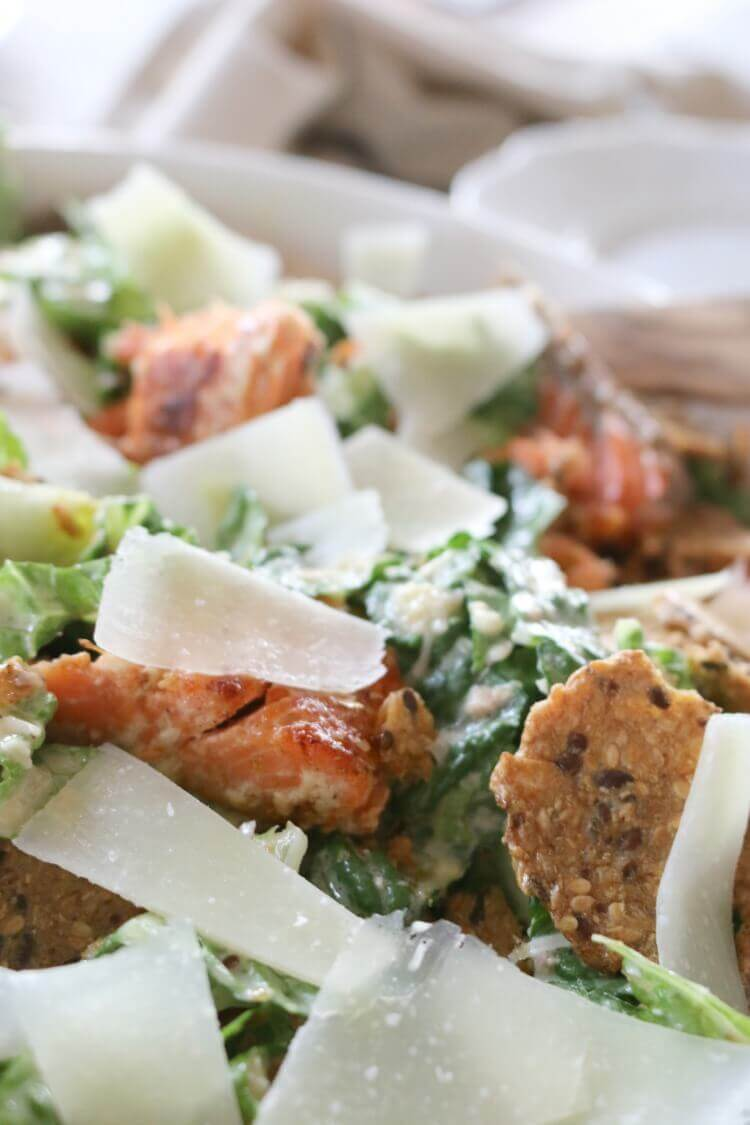 Healthy Caesar Salad -Caesar Salad is best enjoyed with real food ingredients and gluten free crackers for an extra crunch. Perfectly blended with salmon, chicken, or shrimp, it can be made into an easy meal!