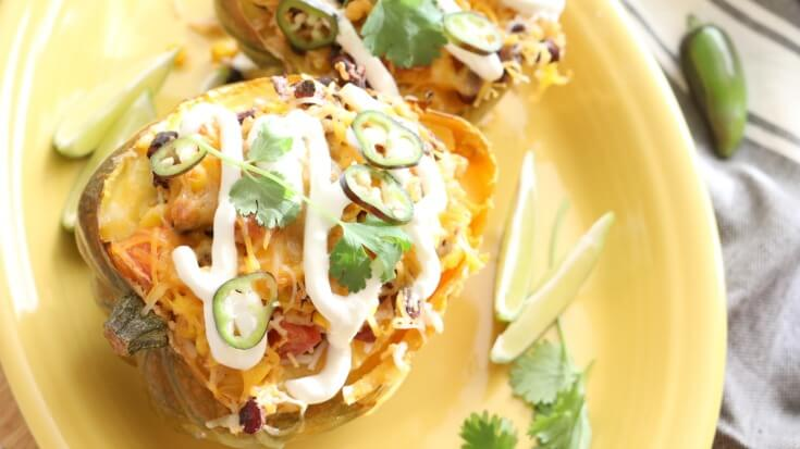 Acorn Squash Burrito Bowl - Add some pizzazz to your Taco Tuesday, by serving these stuffed acorn squash filled with your favorite Mexican flavors and textures. Gluten Free