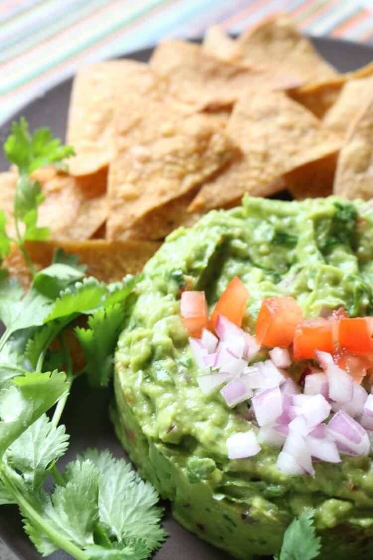 Chunky Guacamole is full of delicious flavors and textures. It's naturally gluten free and is a great dip for Paleo, GAPS or Whole30. Or enjoy with super easy homemade baked tortilla chips.