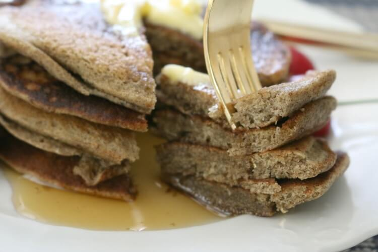 Gluten Free Sourdough Pancakes - These Gluten Free Sourdough Pancakes are rich in tangy buckwheat flavor and delicious. Smother with pastured butter, favorite berries and real maple syrup.