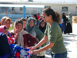 Charitable Preparedness: Giving blankets to girls at Allahuddin Orphanage in Afghanistan. Photo c/o thinkbigadventures.com