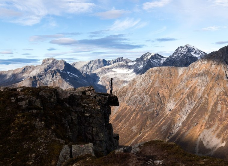 a person standing on the edge of a cliff