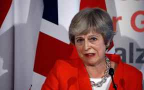 Britain cancels surgeries, theresa may under fire
