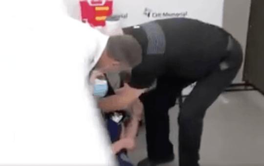 nurse passes out covid vaccine