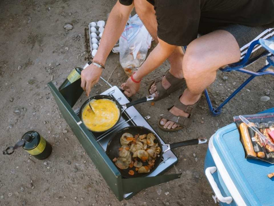 Person frying on a camping stove
