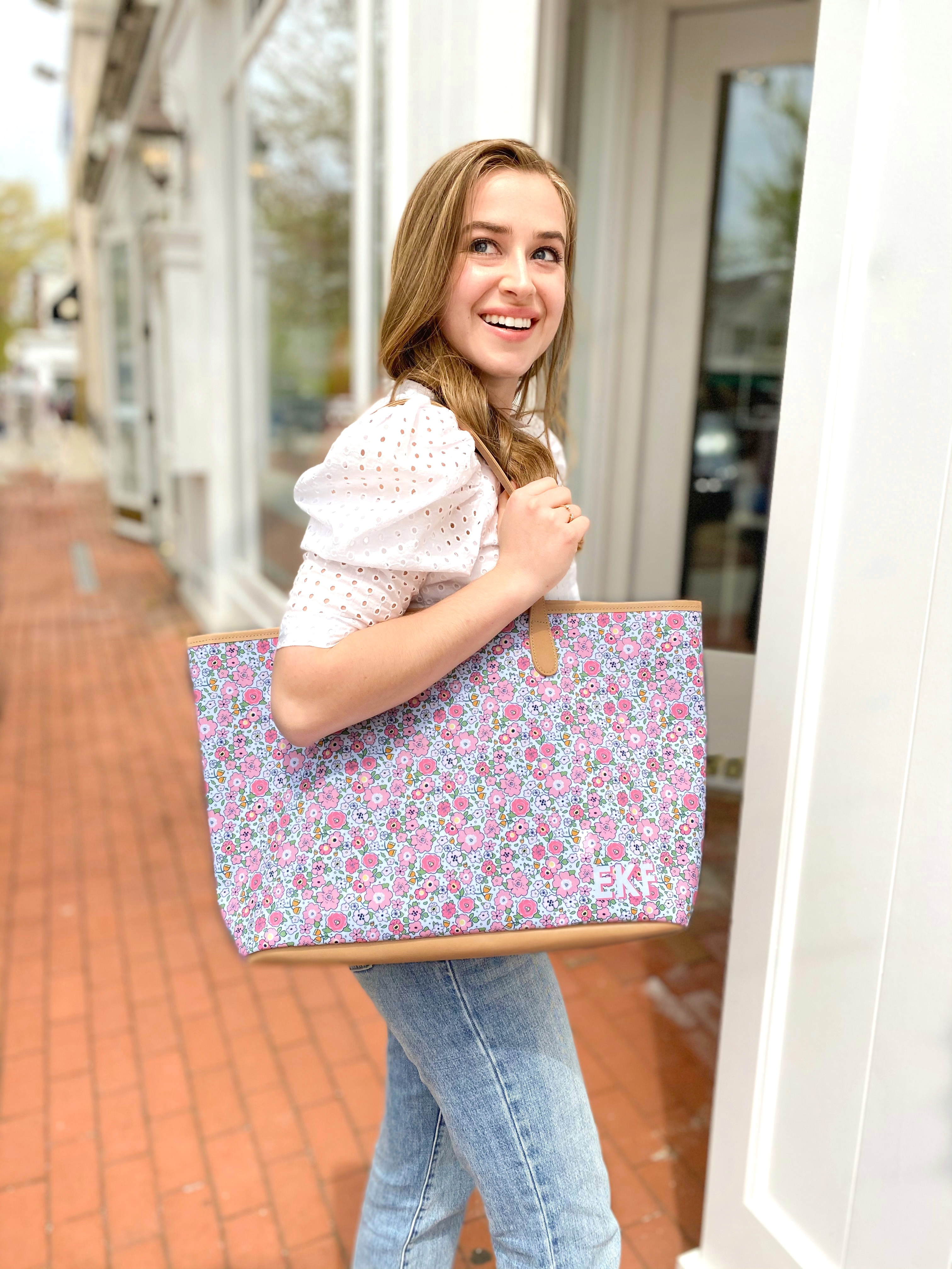 smiling girl with floral barrington tote in st anne's tote