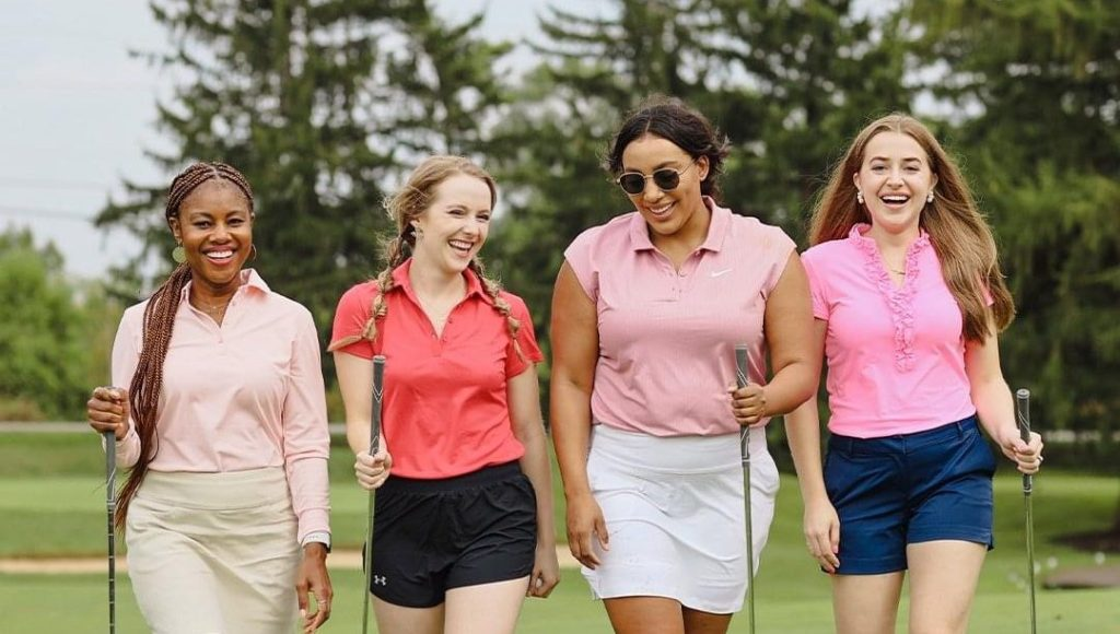 women attend a charity golf fundraiser for breast cancer research