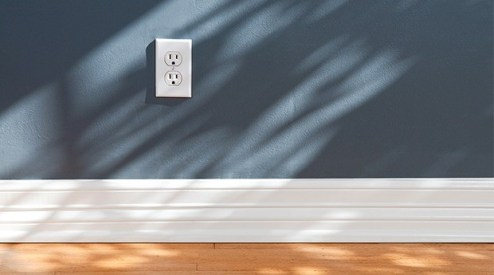 cleaning baseboards using a dryer sheet