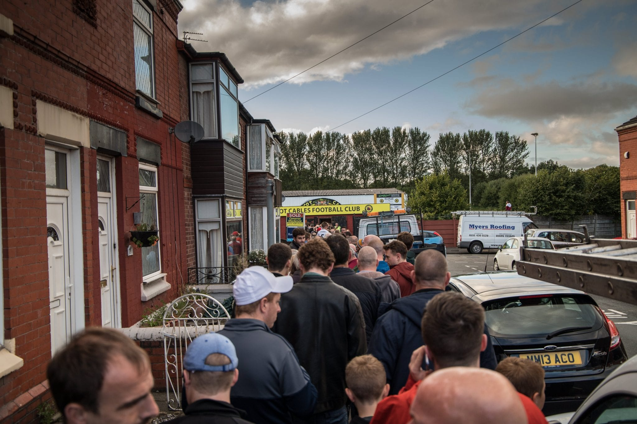 The crowd queuing for the FA Cup tie between Prescot Cables and City of Liverpool