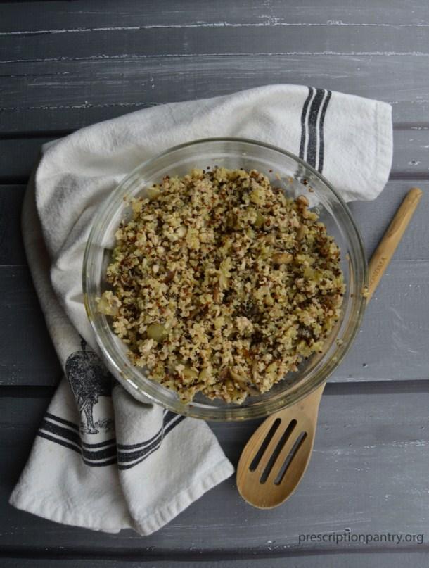 quinoa mushrooms onions stuffing in bowl spoon