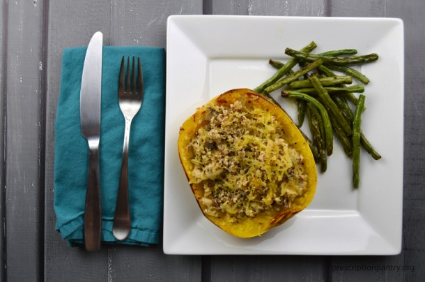 stuffed spaghetti squash on plate green beans