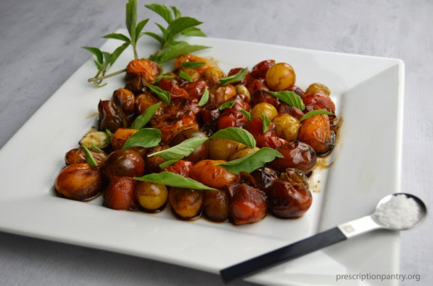 cherry tomatoes basil plate salt