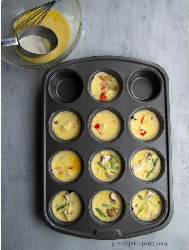 raw eggs mini quiche in muffin pan
