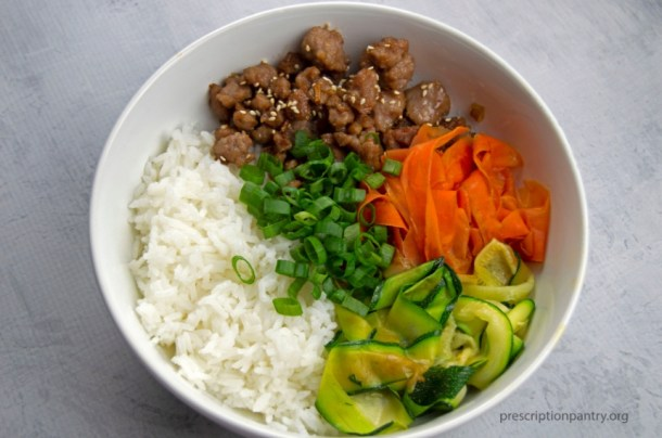 Korean beef bowl carrots rice zucchini