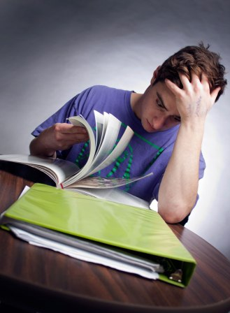 "RENO, NV - Photo illustration of a college student stressing over his workload. In an online poll, 48% of students said they took Adderall, Vyvanse, Ritalin, etc for ""studying."" (View all responses: http://goo.gl/kJc52i). CREDIT: Nate Eng"