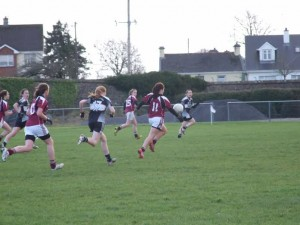 Dervla Higgins of Presentation College Senior Football Team in action