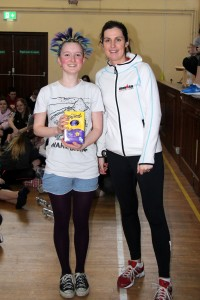 Ruby Atwell (TY) being presented her prize from Ms Cosgrove for the best hairstyle, well done Ruby!