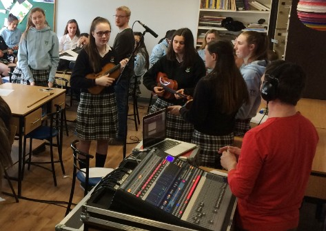The Transition Years enjoy recording their number one hit song at their song writing and recording workshop.