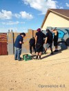 Students from the class assisting with the signature portion of the mural featuring the work of teachers Marcus and Dwayne Manuel.