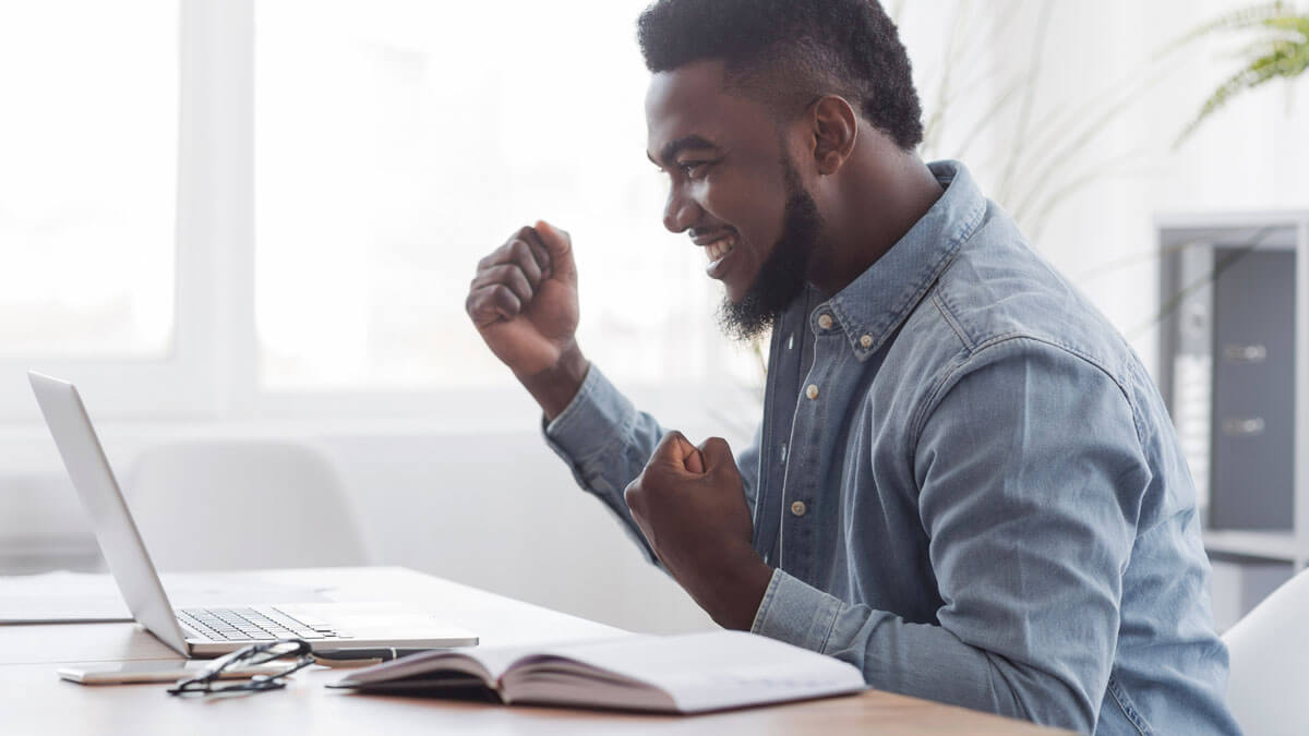 successful man after learning how to prepare for an online interview