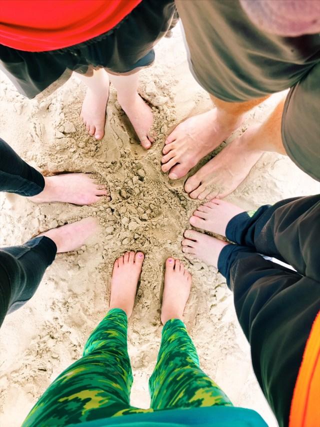 family-feet-sand