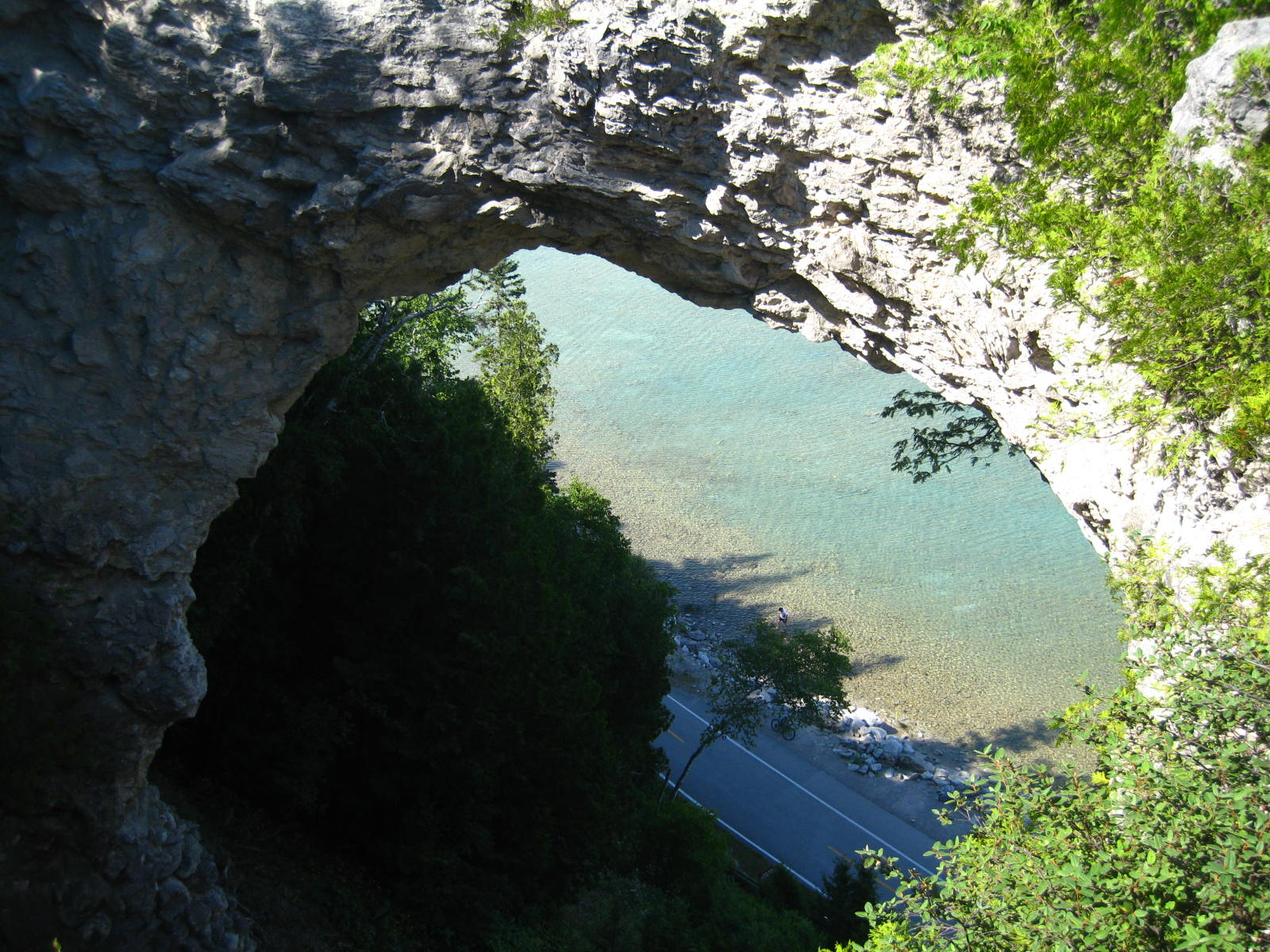 Looking through Arch Rock onto the bike path and Lake Huron.