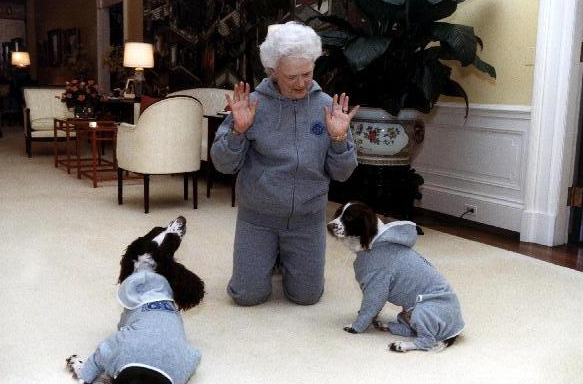 First Lady Barbara Bush wears matching sweatsuits with Ranger and Millie.