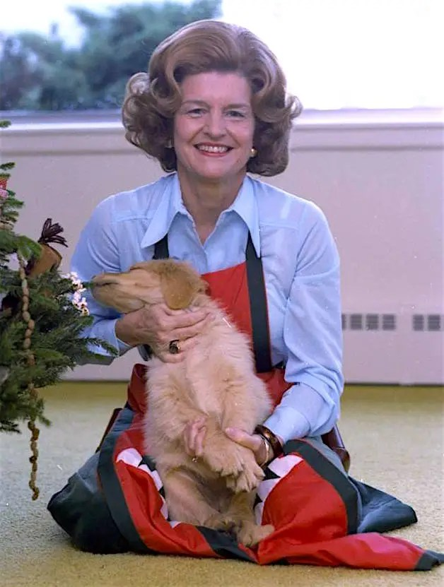 First Lady Betty Ford holds Misty, a golden retriever, Nov. 11, 1975.
