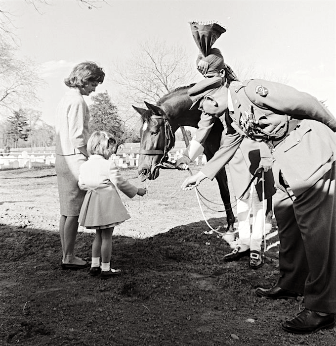First Lady Jacqueline Kennedy introduces her daughter, Caroline, to Sardar, in Arlington, Virginia, 1962.