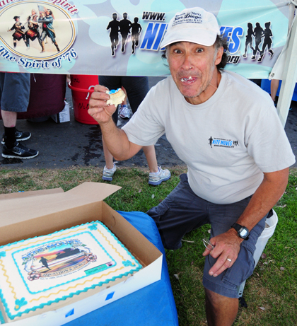 Jake Clinton takes a bite out a cake custom made to celebrate Nite Moves' 25th Anniversary. (Presidio Sports Photo)